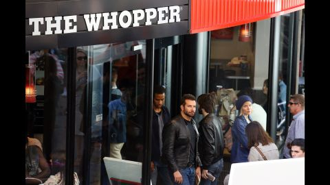 """Bradley Cooper wasn't just stopping by a London Burger King for a Whopper run in July 2014. He was actually doing work -- and in more ways than one. <a href=""""http://www.eonline.com/news/564126/why-is-bradley-cooper-working-at-burger-king"""" target=""""_blank"""" target=""""_blank"""">According to E! News</a>, the Oscar nominee got behind the grill and learned how to flip burgers for a role in an upcoming movie."""
