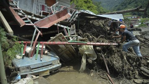 People search for relatives after a landslide in Salgar municipality, Antioquia department, Colombia.