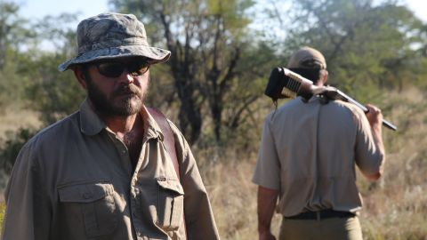 Professional hunter Hentie van Heerden had advice if a rhino charges: Get out of its way.