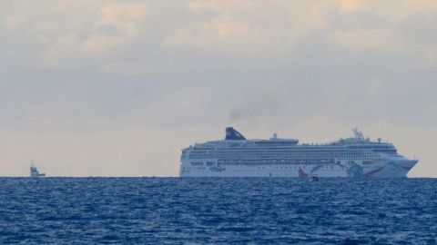 """The cruise ship Norwegian Dawn sits aground near Bermuda's North Channel on Tuesday, May 19. """"Norwegian Dawn temporarily lost power as the ship was departing King's Wharf, Bermuda. The ship's propulsion was affected and, at which time, the vessel made contact with the channel bed. All guests and crew are safe,"""" spokeswoman Vanessa Picariello said."""