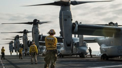 Sailors and Marines prepare to launch MV-22 Osprey tilt-rotor aircraft assigned to Marine Medium Tiltrotor Squadron (VMM) 262 (Reinforced) from the flight deck of the amphibious assault ship USS Bonhomme Richard (LHD 6).