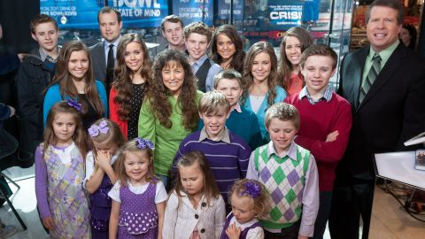 """The Duggar family, stars of the now-canceled TLC show """"19 Kids and Counting,"""" visits """"Extra"""" at its New York studios in March 2014."""
