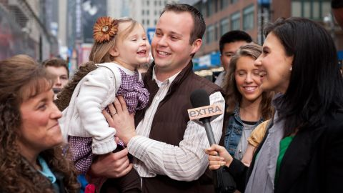 """Hilaria Baldwin (R) interviews Josh Duggar and his daughter during their visit with """"Extra"""" in Times Square on March 11, 2013"""