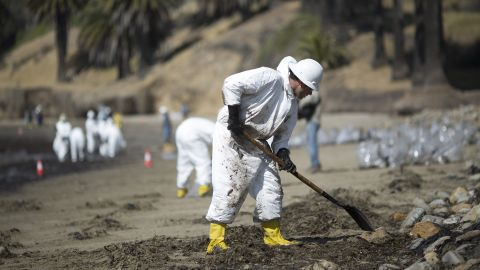 Crews clean up oil on May 20.