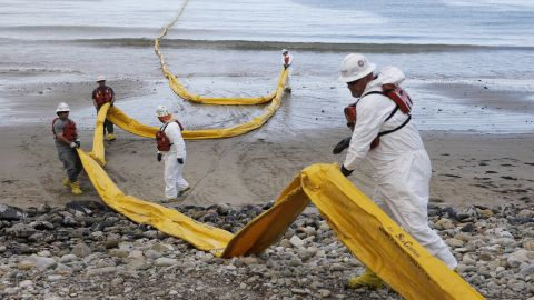 Workers prepare an oil containment boom at Refugio State Beach, north of Goleta, on Thursday, May 21.