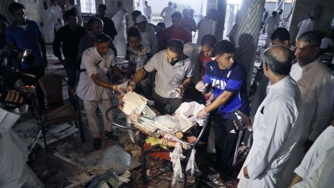 """People search through debris after an explosion at a Shiite mosque in Qatif, Saudi Arabia, on Friday, May 22. ISIS <a href=""""http://edition.cnn.com/2015/05/22/middleeast/saudi-arabia-mosque-blast/index.html"""" target=""""_blank"""">claimed responsibility for the attack,</a> according to tweets from ISIS supporters, which included a formal statement from ISIS detailing the operation."""
