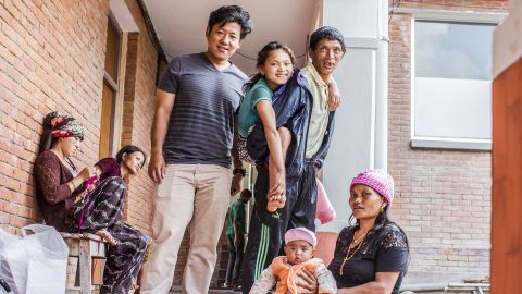 Jwalant Gurung (in tan pants) ran into Maya and her father and brought them back to Kathmandu for care. On the floor are Maya's mother and sister.