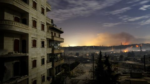 Smoke rises in the Hanano and Bustan al-Basha districts in Aleppo as fighting continues through the night on December 1, 2012.