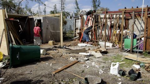 """<strong>Wilma, 2005</strong>: The year might be remembered for the one-two punch of Katrina and Rita, but <a href=""""http://www.nhc.noaa.gov/data/tcr/AL252005_Wilma.pdf"""" target=""""_blank"""" target=""""_blank"""">Wilma</a>, which hit Florida after devastating Mexico's Yucatan Peninsula, would become (as of May 2015) the U.S.'s fifth most costly cyclone. Here, workers remove debris from a Miami flower and plant shop on October 28. Millions were without power in the state."""