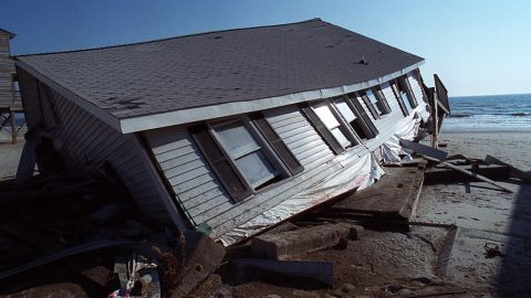 <strong>Floyd, 1999: </strong>Deadly flooding, especially in North Carolina, was one of Floyd's main legacies. Parts of eastern North Carolina and Virginia received 15 to 20 inches of rain, and flooding led to the razing of thousands of buildings -- most of them homes -- from North Carolina to New Jersey.  At the time, it was the deadliest U.S. hurricane since 1972. Here,a beach house, severely damaged by Floyd, sits crumbled sits in the sand on the Oak Island town of Long Beach, North Carolina, on November 10.