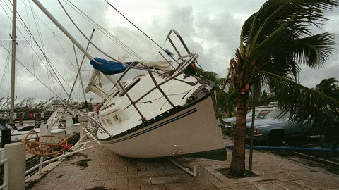 """<strong>Andrew, 1992</strong>: <a href=""""http://www.srh.noaa.gov/mfl/?n=andrew"""" target=""""_blank"""" target=""""_blank"""">Andrew</a> blasted its way across south Florida on August 24 as a Category 4 with peak gusts measured at 164 mph. After raking entire neighborhoods in an around Homestead, it moved across the Gulf to hit Louisiana as a Category 3. It was responsible for 23 U.S. deaths and three in the Bahamas. Here, a sailboat sits on a sidewalk at Dinner Key in Miami after Andrew washed it ashore."""