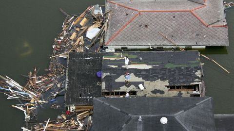 """<strong>Katrina, 2005:</strong> Unforgettable <a href=""""http://www.nhc.noaa.gov/data/tcr/AL122005_Katrina.pdf"""" target=""""_blank"""" target=""""_blank"""">Katrina</a> -- the costliest hurricane and one of the five deadliest to hit the United States, according to NOAA -- devastated the Gulf Coast days after crossing Florida. Flooding destroyed thousands of homes in the New Orleans area alone; storm surges wiped out coastal towns in Mississippi. Here, people stand stranded on a roof in New Orleans."""