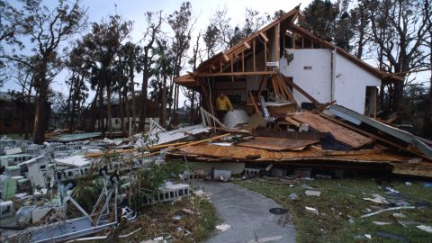 """<strong>Hugo, 1989</strong>: <a href=""""http://www.nhc.noaa.gov/outreach/history/#hugo"""" target=""""_blank"""" target=""""_blank"""">Hugo</a> ripped through the Carolinas, starting with Charleston, South Carolina, on September 22 as a Category 4 after raking the U.S. Virgin Islands and Puerto Rico. Here, a man stands in a destroyed house on September 27 in South Carolina."""