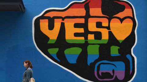 """A woman walks past a mural promoting the """"Yes"""" campaign in favor of same-sex marriage on May 22 in Dublin, Ireland."""