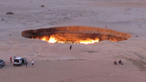 """Welcome to """"The Gateway to Hell.""""  This huge burning gas crater in the heart of Turkmenistan's Karakum desert was the result of a simple miscalculation by Soviet scientists in 1971. After their boring equipment drilled into an underground cavern, a deep sinkhole formed. The scientists took the decision to set the pit alight, thinking that the gas would burn out quickly but it never has."""