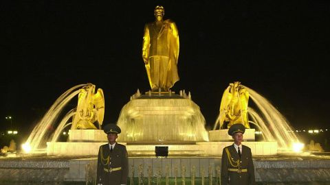 Another statue of Niyazov, with two soldiers standing guard, rises above the country's Independence Monument in Ashgabat. Turkmenistan became independent upon the dissolution of the Soviet Union in 1991.