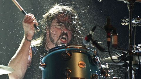 Grohl performs with the supergroup he was part of called Them Crooked Vultures in 2009 in London.