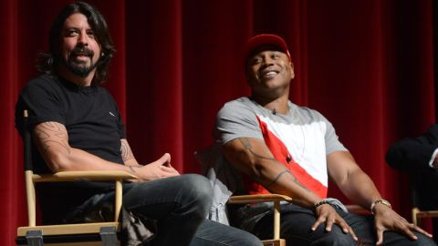 """Grohl and LL Cool J speak during the premiere of """"A Death In The Family: The Show Must Go On,"""" a documentary about how the Grammys adjusted to Whitney Houston's death, in California in 2012."""