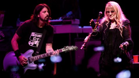 """Grohl and Stevie Nicks perform at a concert to celebrate the premiere of his film """"Sound City"""" in 2013 in Los Angeles."""