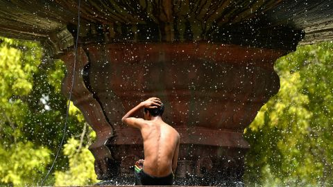A fountain in New Delhi spells relief from the heat on May 26. Two-thirds of India's 1.2 billion people don't have access to electricity, meaning no fans or air conditioning.