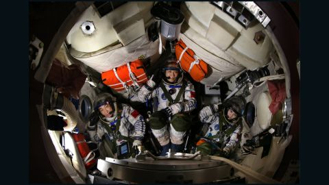 Nie Haisheng, center, Wang Yaping, right,  and Zhang Xiaoguang, left --  the crew of the 2013 Shenzhou-10 mission, China's longest manned spaceflight to date.