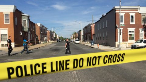 Madison Street is blocked by police due to a barricade situation on May 20, 2015 in Baltimore, Md. Children were extracted at the scene and at least one person of interest was taken into custody. (Karl Merton Ferron/Baltimore Sun/TNS via Getty Images)