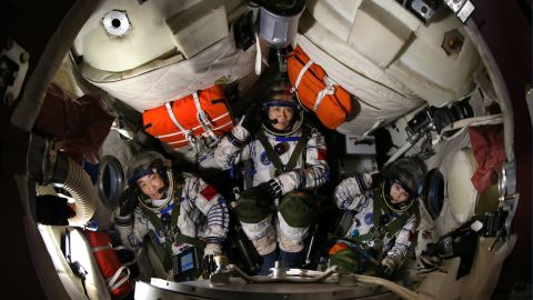 The crew of the Shenzhou-10 mission in their training capsule