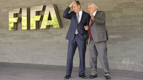 """Blatter <a href=""""http://cnn.com/2012/07/17/sport/football/football-fifa-ethics-corruption/"""">announces that former U.S. attorney Michael J Garcia and German judge Hans-Joachim Eckert (pictured) have joined FIFA</a> to probe allegations of wrongdoing. Their first task will be to investigate a Swiss court document after an <a href=""""http://cnn.com/2012/07/11/sport/football/football-havelange-teixeira-fifa-bribes/"""">investigation into alleged illegal payments made by FIFA marketing partner ISL to former FIFA president Joao Havelange</a> and former executive committee member Teixeira. However, they will also investigate old cases -- including the process surrounding the decision to award the 2018 and 2022 World Cups to Russia and Qatar. Meantime, Bin Hamman is again suspended over new corruption allegations by the Asian Football Confederation (AFC), which he used to lead. Bin Hammam says he is innocent but <a href=""""http://www.fifa.com/governance/news/y=2012/m=12/news=mohamed-bin-hammam-resigns-from-football-banned-for-life-1973422.html"""" target=""""_blank"""" target=""""_blank"""">in December 2012 he resigns all his football positions after a FIFA report finds him guilty of violating the conflict of interest clauses </a>in its Code of Ethics and bans him from all football-related activity for life."""
