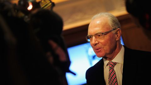 """German footballer Franz Beckenbauer, the only man to win the World Cup as captain and coach,<a href=""""http://cnn.com/2014/06/13/sport/football/franz-beckenbauer-fifa-football/""""> is provisionally suspended from any football-related activity for 90 days</a> for failing to cooperate with a FIFA corruption investigation. FIFA says Beckenbauer had been asked to help with its Ethics Committee's probe into allegations against Qatar 2022 and the World Cup bidding process. Beckenbauer tells German media that he did not respond to questions by the chairman of the Ethics Committee's investigatory body because they were in English and he did not understand them."""