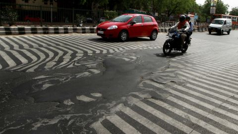 A road melts near Safdarjung Hospital in Delhi after temperatures rose to 45 C on May 24, 2015.