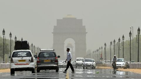 Few people brave the streets near the India Gate in New Delhi on Thursday, May 28.