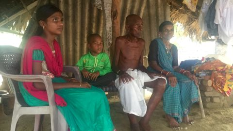 Mallayia Baddula sits with his family in the stiflying heat of their hut in Perepally, outside Hyderabad.