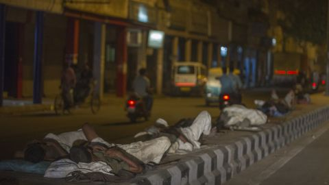 Men sleep on concrete road dividers during a heat wave in Delhi, May 27, 2015.
