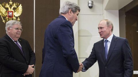 U.S. Secretary of State John Kerry shakes hands with Russia's President Vladimir Putin, next to U.S. Ambassador to Russia John Tefft at the presidential residence Bocharov Ruchey in Sochi.
