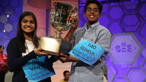 Caption:NATIONAL HARBOR, MD - MAY 28 Speller Vanya Shivashankar (L) of Olathe, Kansas, and speller Gokul Venkatachalam (R) of St. Louis, Missouri, hold up the trophy after winning the 2015 Scripps National Spelling Bee May 28, 2015 in National Harbor, Maryland. Shivashankar and Venkatachalam were declared co-champion at the annual spelling competition. (Photo by Alex Wong/Getty Images)