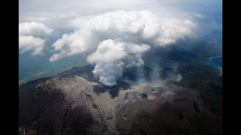 """Mount Shindake spews ash on Kuchinoerabu Island in Yakushima, Japan, in May 2015. The volcano <a href=""""http://www.cnn.com/2015/05/29/asia/japan-volcano-evacuation/index.html"""" target=""""_blank"""">erupted shortly before 10 a.m. local time</a>, the Japan Meteorological Agency said."""