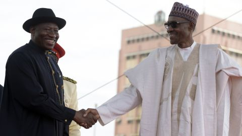 Former Nigerian President Goodluck Jonathan, left, shakes hands with Buhari after handing over power.