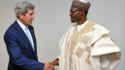 U.S. Secretary of State John Kerry shakes hands with Nigerian President Muhammadu Buhari on Wednesday, May 29, shortly after Buhari's inauguration in Abuja, Nigeria.
