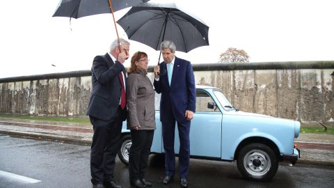 During a tour of the Berlin Wall memorial on October 22, 2014, in Berlin, Kerry and German Foreign Minister Frank-Walter Steinmeier, left, chat with Regina Webert-Lehmann, who in 1989 fled from communist East Germany in her Trabant car (pictured) to Hungary shortly before revolutions swept Eastern Europe. Kerry and Steinmeier met with students and walked along a still-standing portion of the wall that divided East and West Berlin and whose fall 25 years ago marked the end of the Cold War.