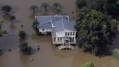 Floodwaters surround a house near the San Jacinto River in Kingwood on May 30.