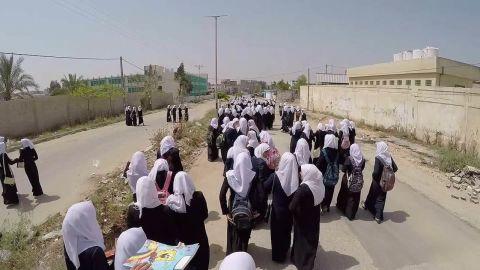 gaza school girls walk home drone natpkg_00001018.jpg