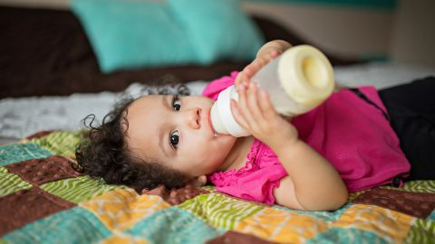 """""""I've heard people say 'There's no bonding in this photo,' but Rachel, she is a spitfire,"""" Whitman said of one baby she photographed self-feeding with a bottle. """"Even at that small, she's very independent."""""""