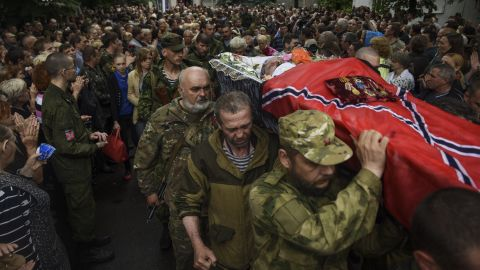 """Pro-Russian rebels carry the coffin of <a href=""""http://www.cnn.com/2015/05/24/europe/ukraine-separatist-commander-killed/index.html"""">prominent separatist commander Alexei Mozgovoi</a> during his funeral in Alchevsk, Ukraine, on Wednesday, May 27."""