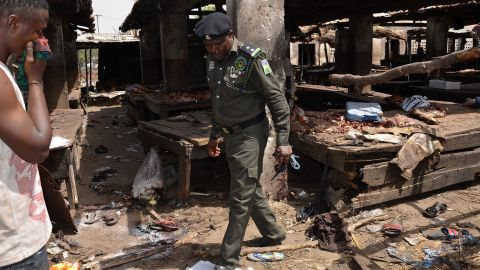 A Nigerian policeman inspects the site of a suicide attack at a busy cattle market in the northeastern Nigerian city of Maiduguri on June 2, 2015. At least 13 people were killed in the attack, the Red Cross and civilian vigilantes battling Boko Haram said. The blast in the Borno state capital happened as traders were wrapping up business for the day. AFP PHOTO / STRINGER (Photo credit should read STRINGER/AFP/Getty Images)