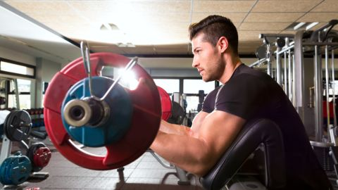 <strong>Preacher curl: </strong>There is no stabilization of your core or lats because your shoulder blades are out of place and you are in a forward posture.