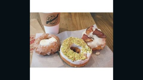 """The first Friday in June is <a href=""""http://www.cnn.com/2015/06/03/living/national-donut-day/index.html"""" target=""""_blank"""">National Donut Day</a>. In celebration, we asked you to <a href=""""https://instagram.com/p/3eWfV0l81r/"""" target=""""_blank"""" target=""""_blank"""">show us</a> what doughnuts look like where you live. Click through to see some of your drool-worthy snaps such as this one from from Dolly Lee. Her photo, featuring a carrot cake doughnut, a pistachio-meyer lemon doughnut and maple-bacon cruller, sure is making us hungry! Lee loves that doughnuts are a """"sweet way to start the day."""""""