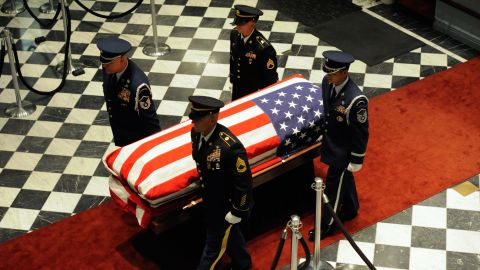 An honor guard carries Biden's casket out of  Legislative Hall in Dover, Delaware.
