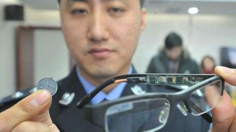 A police officer displays a device used by students to cheat in previous years.