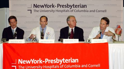 Dr. Craig Smith, right, answers a reporter's question about Clinton's health after Clinton had quadruple bypass surgery in September 2004. Clinton was hospitalized after suffering chest pains and shortness of breath. Doctors announced that some of Clinton's arteries had been blocked more than 90%.