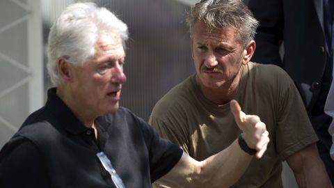 Clinton and actor Sean Penn visit a cholera treatment center in Port-au-Prince, Haiti, in February 2015.